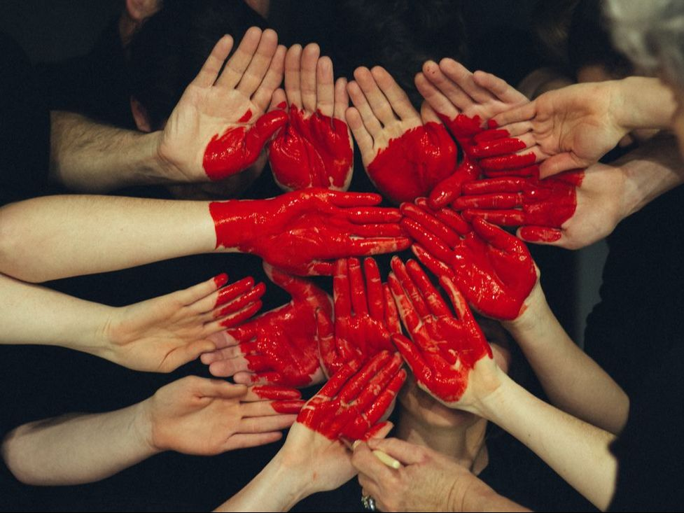 Picture of many hands painted with red heart