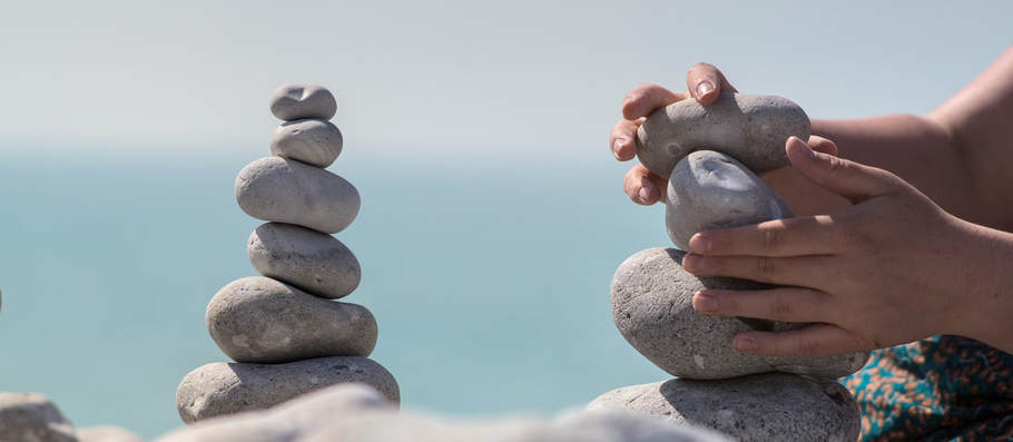 Picture of hands balancing rocks